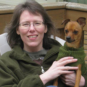 Tonya Mork with her small dog in a sweater