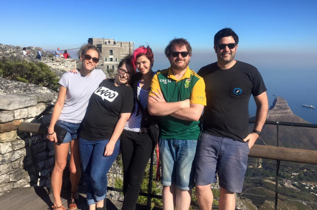 Five members of the WooCommerce team on a hill over Cape Town South Africa
