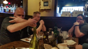 Some family being silly at dinner