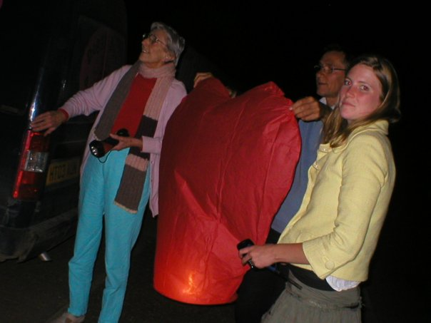 Family with a heart shaped chinese lantern.