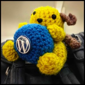 Small yellow crocheted wapuu