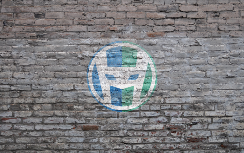 HeroPress logo on a grey brick wall