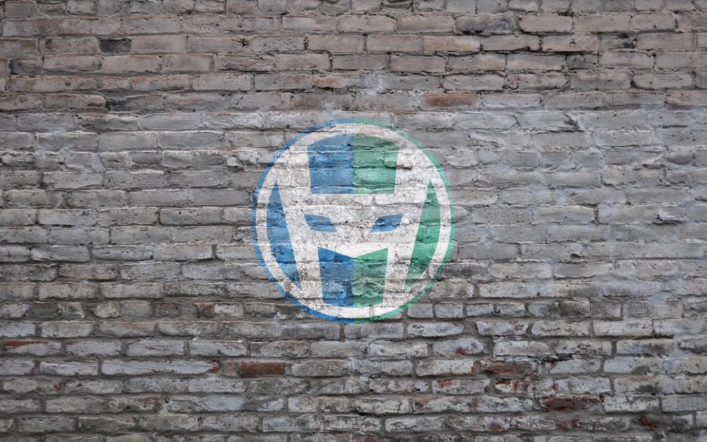 HeroPress logo on a grey brick wall