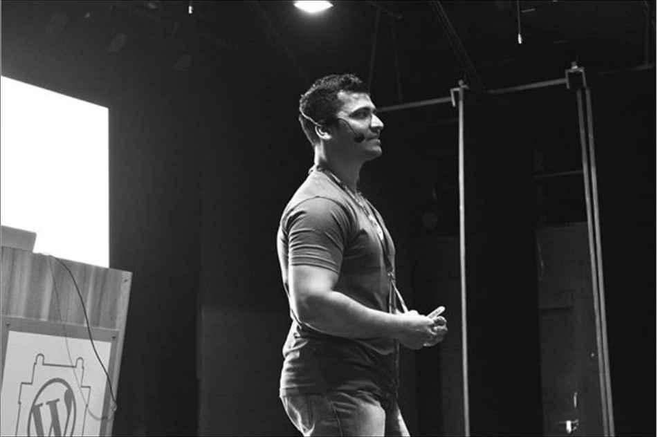Imran speaking on stage