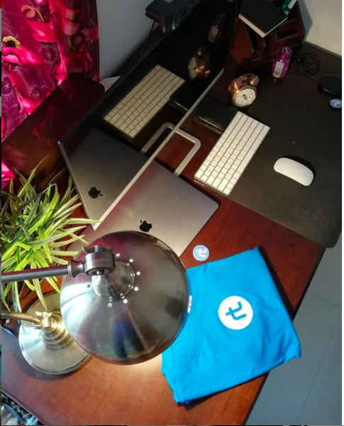 Desk with an rtCamp shirt on it