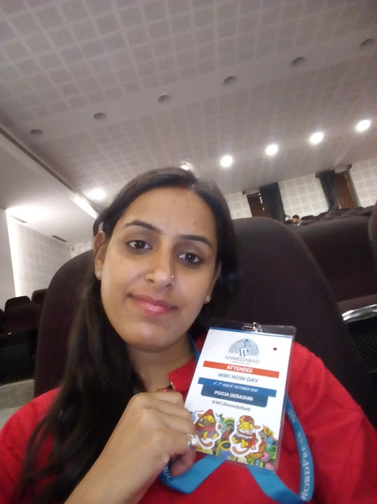 Pooja with a WordCamp badge