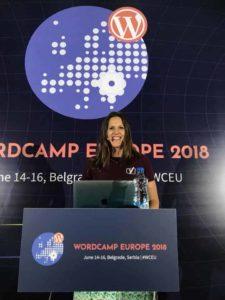 Marieke bhind a podium at WCEU
